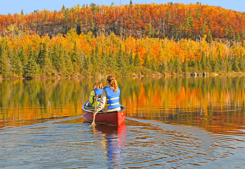 Canoeing Mic Mac Lake<br /> <br /> We rented two of the canoes which are located at the camp and canoed across Mic Mac Lake. The colors couldn't have been better.  It almost seemed magical floating along the glass like surface of Mic Mac Lake.  I think both Kate and Jenny will remember this shared moment for some time. It is so important to make those outdoor memories with your kids or grandkids.