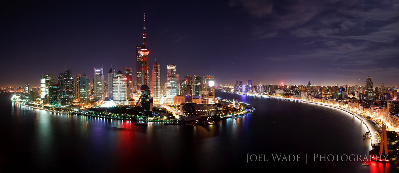 Wild Wild East<br /> <br /> The Pudong New Area rises above the east bank of the Huangpo River in Shanghai, a little piece of Blade Runner in one of the oldest cities in the world.  This panorama was composited from 10 separate images from the VUE roof deck bar of the Hyatt on the Bund.  Like most modernizing nations, China is a land of vast contrasts, where local hipsters and ex-pats mingled amongst outdoor jacuzzis and expensive bottles of champagne at the bar, while coal barges (and sometimes the occasional pig carcass) floated slowly along in the river below.<br /> <br /> 10 frame composite, ISO 200, 24mm, f9.0, 20 second exposure.
