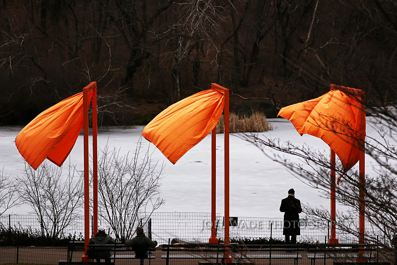 "The Gates – New York City<br /> <br /> Several years ago I was fortunate enough to be visiting Manhattan for work on the opening day of Christo's ""Gates"" art installation in Central Park.  The frozen park in February was a perfect contrast to the over 7,500 fabric and metal gates installed in the park for a short two-week stint.<br /> <br />  ISO 400, 90mm, f/5.6, 1/800 second exposure."