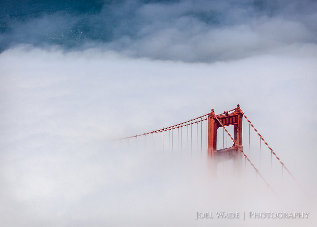 Aloft<br /> <br /> By now you know I'm a bit obsessed with the Golden Gate Bridge.  So smitten am I, that I was given an air tour of the bay as a birthday present.  As luck would have it, I managed not only to bring home a few unique angles, but was also blessed with the gorgeous summer fog.  Hope you enjoy! <br /> <br /> ISO 400, 110mm, f8.0, 1/1600 second exposure.