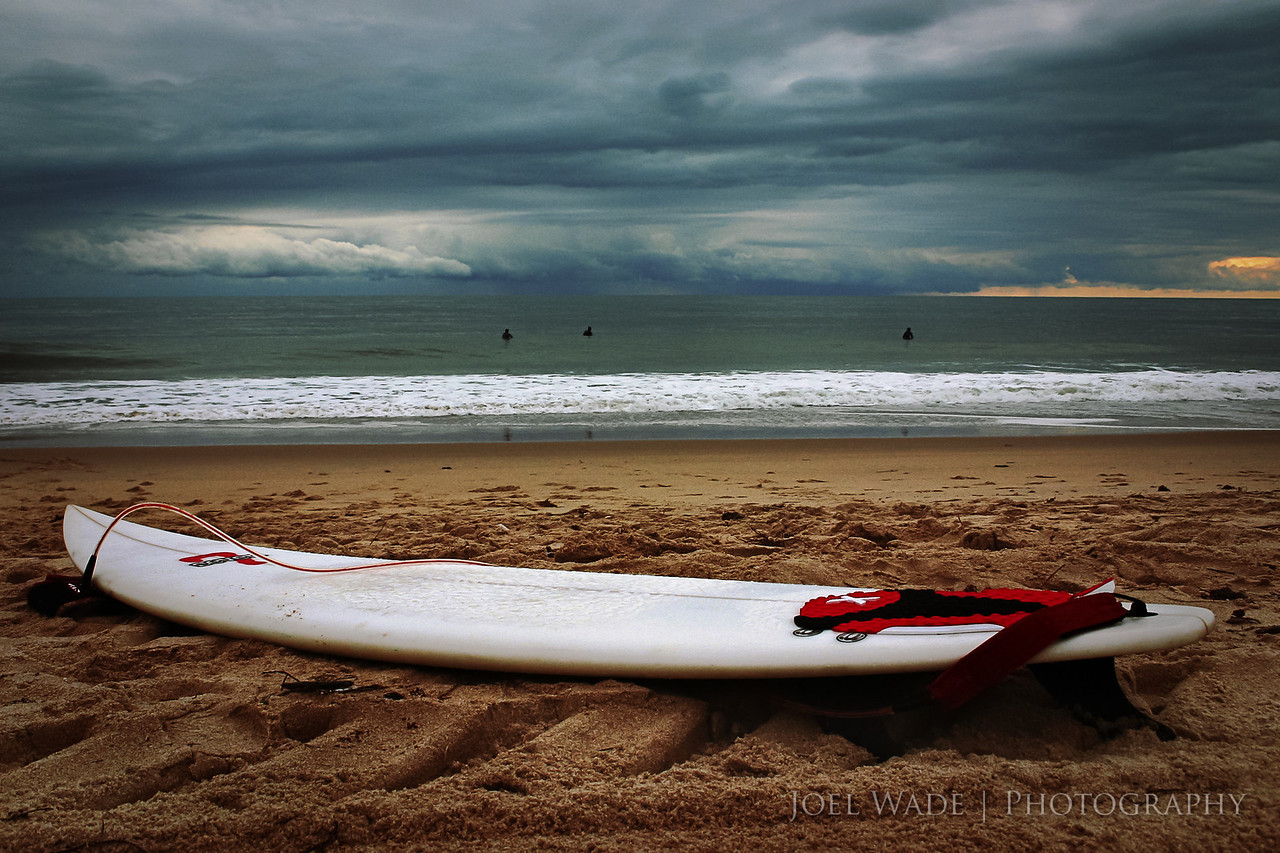 Last Ride of the Day<br /> <br /> It's getting dark a little earlier, and though she hasn't left us quite yet, I'm already missing summer.  Shot this many years ago near Vero Beach Florida at dusk with a storm brewing off at sea.  <br /> <br /> ISO 400, 24mm, f10, 1/160 second exposure.