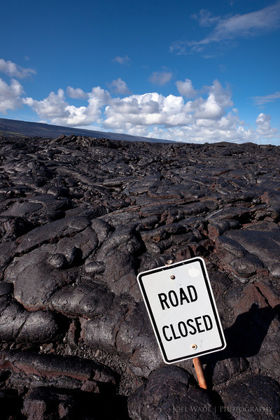 "Road Closed, Big Island, Hawaii<br /> <br /> Off to the ""Garden Island"" of Kauai tomorrow to celebrate my birthday with the family.  Know of any must see spots or photo-ops?  I'm all ears!  Here's a shot from the southern tip of the Big Island where some of the most recent lava flows meet the ocean.<br /> <br /> ISO 200, 17mm, f11, 1/250 second exposure."