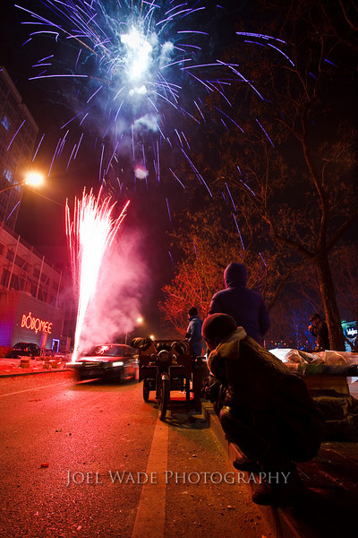 Year of the Tiger – Beijing<br /> <br /> Off to China in a matter of hours for a week or so of business… Here's one of my favorite shots from a previous trip to Beijing during the New Year celebrations.  The Chinese take their fireworks very seriously.<br /> <br />  ISO 400, 17mm, f/5.6, ½ second exposure.