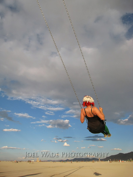 Swing Life Away<br /> <br /> If you've never been to Burning Man, it's hard to explain.  Go burners go!  Shot with a Canon point and shoot near dusk on a glorious day on the playa.<br /> <br /> Canon Point and Shoot.
