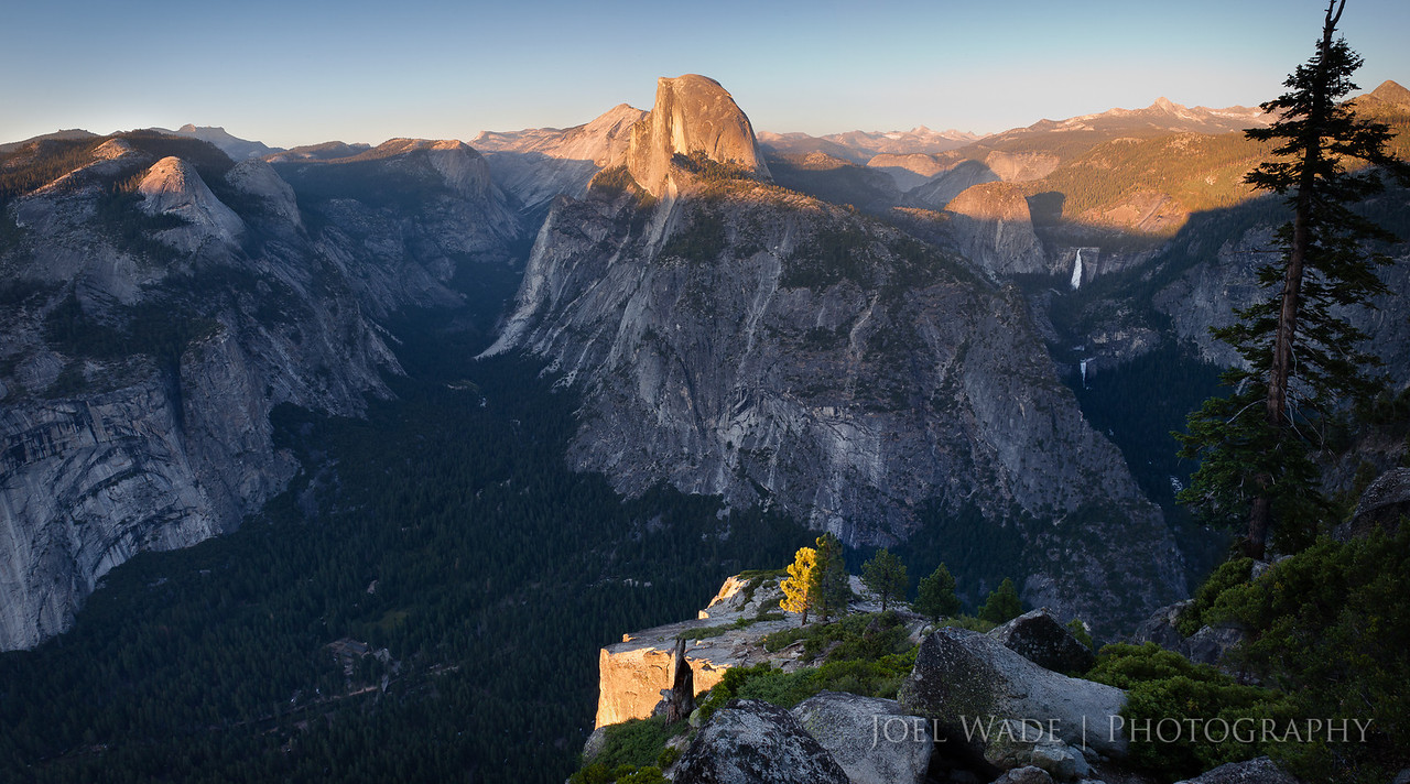 Glacier Point View, Yosemite<br /> <br /> Took a mid-week solo trip to Yosemite last summer to soak in the sights, burn some vacation days, and spend some time smelling the roses.  Definitely clears the mind to be by yourself for an extended period of time- a rare occurrence for me.  For this shot I picked out my spot and spent about 3 hours waiting for the light to fall, munching on snacks and enjoying the beauty of nature.  I merged 5 separate shots from the tripod into a single panoramic image.<br /> <br /> ISO 100, 17mm, f11, 1/10 second exposure.