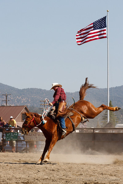 Jump Kick<br /> <br /> The American West is still alive in many parts of the country, like at this small local rodeo in Davenport, California last Fourth of July.<br /> <br /> ISO 400, 105mm, f/10, 1/800 second exposure.