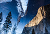 """El Capitan<br /> <br /> I've been to Yosemite many times, but never during the winter… so was incredibly excited to make it up a couple of weeks ago the day after a fresh snowfall.  For this shot I wanted to try to grab something a little different from the classic views, and also wanted to make it clearly """"winter"""".  Getting up at dawn was a frigid affair, but the first early morning light on El Capitan as viewed through the water and ice on the Merced River made the frozen fingers worth it.  Though potentially a little confusing at first glance, I'm hoping viewers slowly come to see the multiple layers of depth, from the sunlight on the cliffs, to the ice and snow on the water's surface, to the subtle leaves and needles barely visible on the river bottom.<br /> <br /> ISO 100, 29mm, f18, .6 second exposure."""
