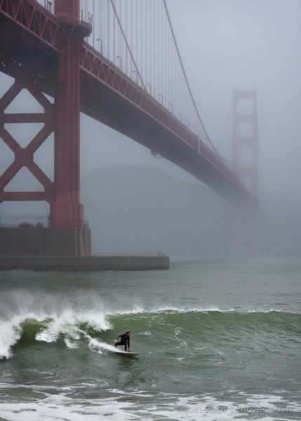Surfing the Gate – San Francisco<br /> <br /> The guys who surf off San Francisco's fort point are a rare breed.  Freezing waters, boat traffic, and some nasty sharp rocks keep all but the truly committed off this break.<br /> <br /> ISO 400, 58mm, f/8, 1/250 second exposure.