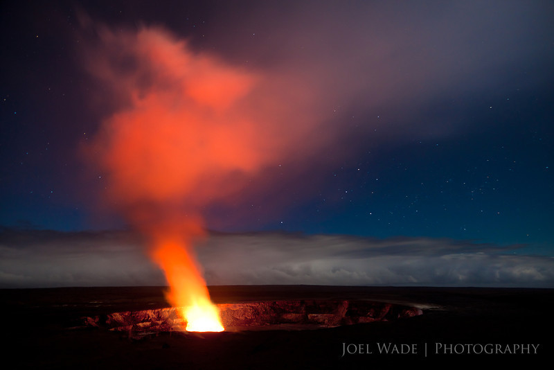 Pele's Breath<br /> <br /> The Kilauea caldera on the big island of Hawaii.  During the day this simply looked like a white plume of steam… but at night the molten lava lit up the smoke with a bright crimson red.  When the wind died down you could clearly hear it bubbling and hissing.  Amazing to behold!  I stayed here for close to 2 hours, and was rewarded with the clouds clearing enough to catch the starry sky as well.  Never got to actually see the lava… so that's still on the bucket list!  (Pele refers is the name of the Hawaiian volcano goddess)<br /> <br /> ISO 400, 28mm, f4.5, 30 second exposure.
