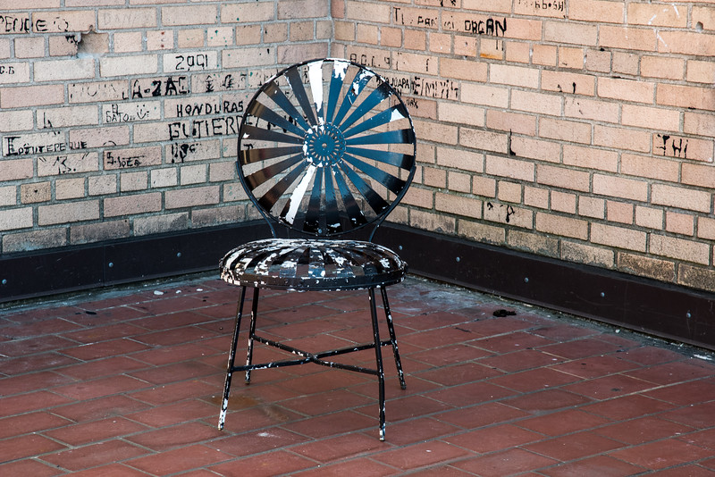 Chair at INS Building  (Note Grafitti on wall, names of immigrant prisoners held in custody