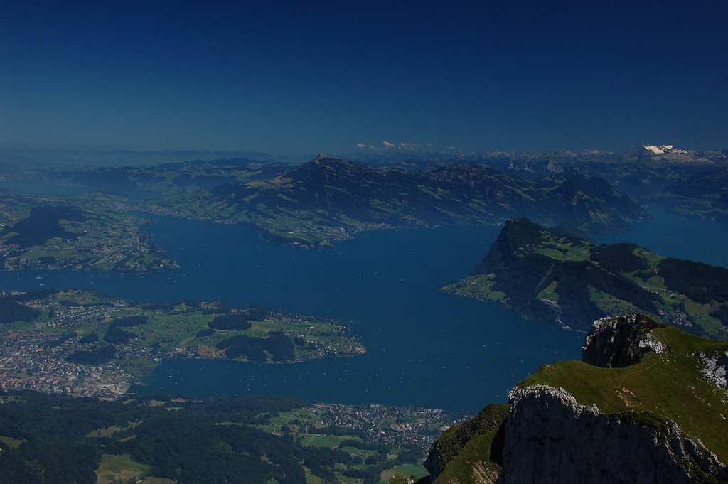 July 15 <br /> <br /> View from Mt. Pilatus <br /> <br /> Currently in Switzerland - mostly in and around Zurich. We went up to the top of Mt. Pilatus (just outside Lucerne) and could see the Swiss Alps to the south. This is a view of Lake Lucerne and Vierwaldstattersee. It was quite hazy given the time of the day, and I used my polarizing filter, but am not sure how well it turned out - don't have my laptop with me and am using a friend's computer...
