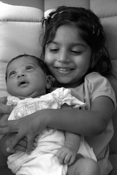 June 26<br /> <br /> Two sisters <br /> <br /> Avantika was happy to hold Sahana, but only for a minute!
