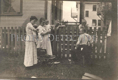 In honor of Women's History month I couldn't resist this picture. A proud mother shows off the new baby to the neighbors. c. 1915.