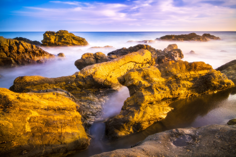 Sunlit beach rocks in Malibu