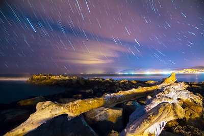 Star trails over ocean Jetty