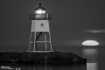 Grand Marias Lighthouse and rising moon, Minnesota north shore.