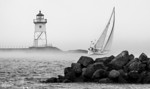 Sailboat leaving Grand Marais Harbor and venturing into foggy Lake Superior (Gichigami)