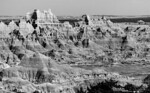 Badlands National Park, Pine Ridge Reservation viewing one of the many dramatic views of the South Dakota badlands. Over the eons weathering has revealed the sedimentary layes of the ancient seabed tha predominated long ago.