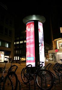 """Reklame er mental forrurensing. Den maser: \""""Du er dårlig! Kjøp mer!\"""" Tårnene i Oslo skulle ikke vært oppført! Når holdes løftet om å fjerne? -- by Børge A. Roum"""