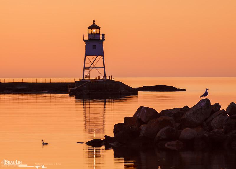 First Light Harbor<br /> Grand Marais harbor & lighthouse, Minnesota's north shore.