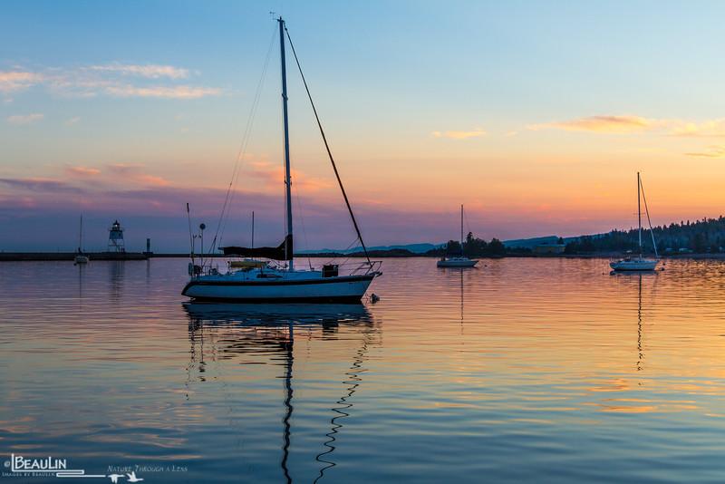 Harbor at Dusk<br /> Lighthouse and sailboats at Grand Marais harbor, along Minnesota's north shore of Lake Superior.