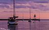 Harbor at Dusk<br /> Grand marais harbor, lighthouse & moored sailboats.  Minnesota's north shore.