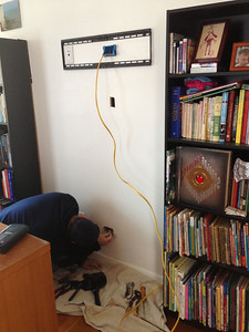 2013-01-27: A (n amazing) local electrician helps me fish wires and install the outlet for the new TV.