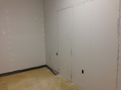 2013-01-22: The wall goes up separating what will be the server room from the kitchen in our new office at PRI