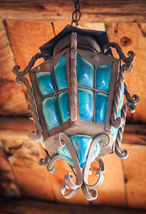 Tuesday 15 April 2014: BLUE LIGHT IN OLD TOWN  I don't know how many times I have gone to Old Town in Albuquerque to shoot, but suffice it to say, it has been a LOT! In all those times, I never noticed a whole series of these antique, glass and wrought iron lamps in front of one of the establishments. This one is my favorite, but it was a difficult choice between it and the others right beside it. They are all different and all incredibly beautiful. I guess it just goes to prove that there is beauty all around us, all the time...if we would just open our eyes and take the time to see it.
