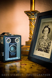 "Wednesday 2 April 2014: MOM - SCHOOL DAYS  I was wandering around the house looking for something that I could use to create a pic for today, and my eye fell upon my vintage Brownie camera. Although the camera is quite interesting, I didn't think it had ""enough"" to give my followers all they have (hopefully) come to expect from me.   So I decided to use it as a central piece in an ""antique"" still life. Sadly, we don't have a lot of antique things just laying around, so instead, I decided to use something that might have looked ""in place"" when that camera was in it's prime...my mom's school photo...vintage 1938. She was beautiful then and she is beautiful still. She just turned 88 and is rocking it in an assisted living facility in Pennsylvania, where she does her best to help the ""old people""!! Love ya Mom."