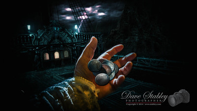 "Wednesday 22 January 2014: PIECES OF EIGHT ""Eight"" is the topic of the day, and so not only are these ""Pieces of Eight"", there are also eight of them (just to be safe.) Believe me when I tell you, it is harder than you might think to find gold pieces from the 1700's, and even harder to find a pirate galleon that will let you come aboard to take some photographs (especially when you just happen to be carrying eight pieces of gold - and a Canon 5DIII!!)   But I lucked out...I snuck aboard in the middle of the night, during a terrible storm, while all the blood-thirsty pirates were below deck - and took my shot. :-) It is absolutely amazing what a guy will do to get the shot he wants for his pic of the day...isn't it??"