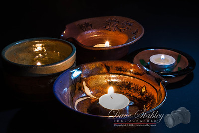 "Tuesday 21 January 2014: IN A BOWL Lots of things come ""In A Bowl""...rarely do you find lit candles in a bowl, so that's what I went with. I hate being just one more photographer shooting the same shot that a lot of the other people are shooting. I thought the hand-thrown and glazed features on the bowls added a tiny bit of additional interest.  Why didn't I just fill the bowls with candy you ask. Actually, that was my first choice. The problem was that you really couldn't tell what kind of candy it was and that left the whole image a bit ""flat"". So...substitute fire for candy and I think we have a winner."