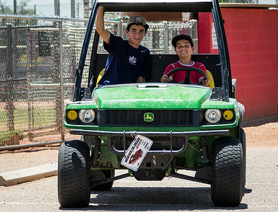 "Monday 14 July 2014: 1st DRIVING LESSON  As I was walking up the street at lunchtime, I heard this ""odd"" engine sound coming up from behind me in the street and getting closer. I turned to see these two young lads, driving the John Deere Gator. Shortly after they passed me, they turned into a parking lot where the older one jumped from the driver's seat and was replaced by the younger one. I don't know how old you need to be to drive one of these things, but whatever the age, he certainly didn't appear to be quite ""old enough"". That supposition was borne out almost immediately when he attempted to back up and turn around...it was almost comical!   I remember my first driving lesson when several of us took a friend's ""field car"" (not legal on the highway), and drove it around the back country roads without permission. We never got caught, but back then there was nobody around with a digital camera! :-)"