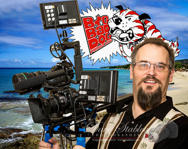 Saturday 15 March 2014: DAVE - BIG BAD DOG  This is my son Dave. As you may have guessed from all the cameras, he is a videographer...and a darn good one if I do say so myself.   In less than two weeks from now, he has the daunting task of videoing three rock cruises - in a row. Really big name groups that most of us would give a left arm to see - he gets to meet and record. Well, like they say, it's a tough job, but somebody's gotta' do it. I'm just glad it's my son!!