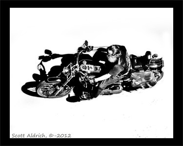 Biker, Anchorage Alaska - taken from the 10th floor of the Capt. Cook, Hotel. June 21, 2012