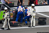 July 31 - Bobby Hamilton Jr. comes to the attention of his pit crew after blowing a right front tire and hitting the wall.
