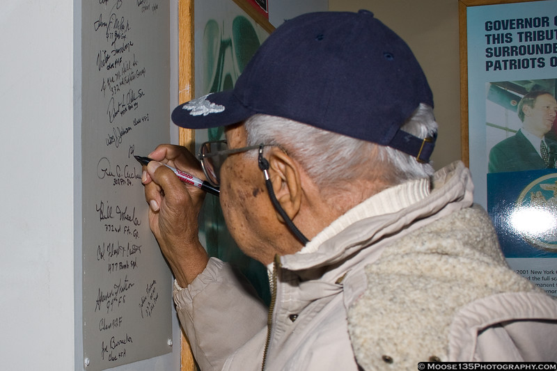December 5 - Raymond Cassagnol, Tuskegee Airman, signs the Tuskegee Wall of Fame at the American Airpower Museum.