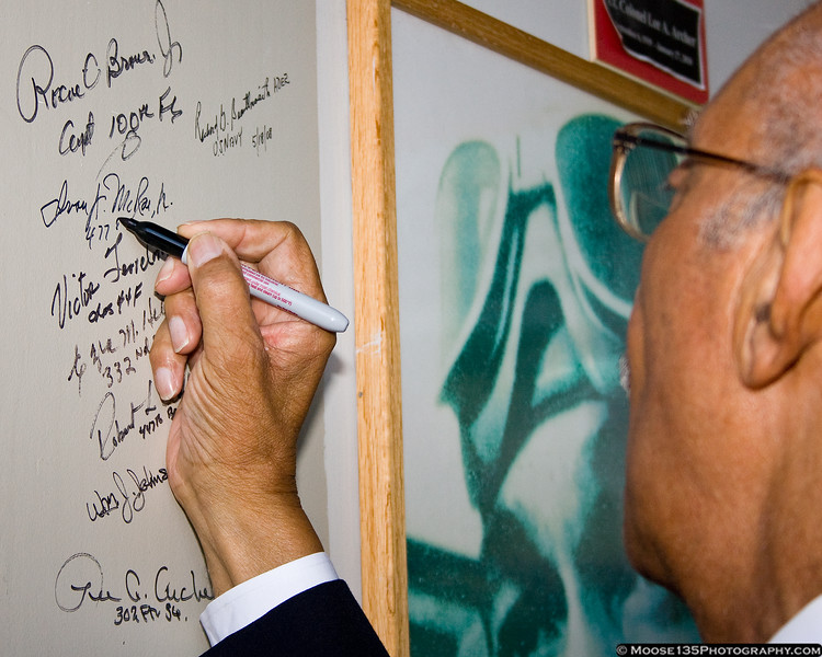 October 7 - Tuskegee Airman Ivan McRae signs the Tuskegee Wall of Honor at the American Airpower Museum.  In a ceremony at the museum, Congressman Steve Israel presented Mr. McRae with his copy of the Congressional Gold Medal awarded to the Tuskegee Airmen.