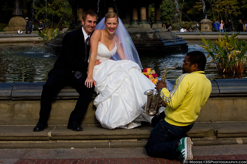 October 24 - Sunday in the park...sax player in Central Park serenades newlyweds at Bethesda Fountain.