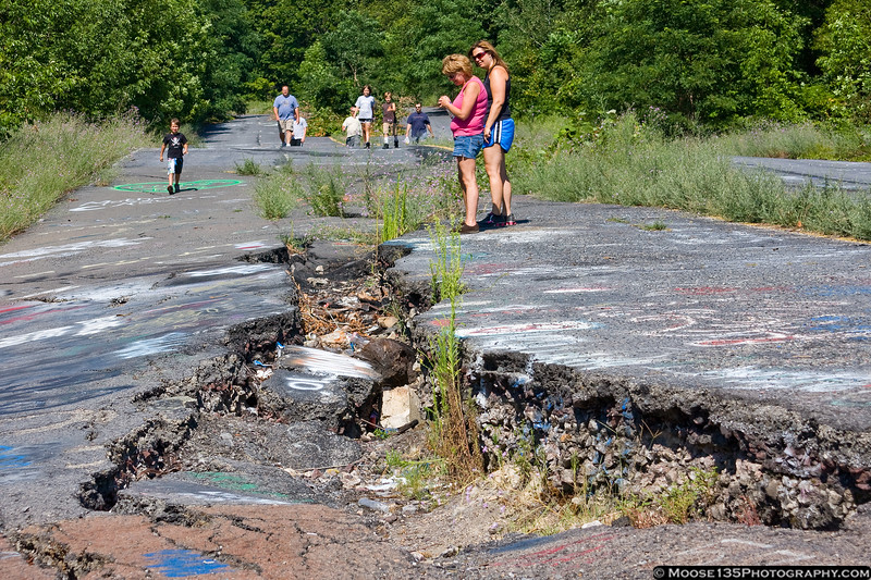 July 11 - Old Highway 61 was torn apart by a massive coal fire under ground Centralia, PA.