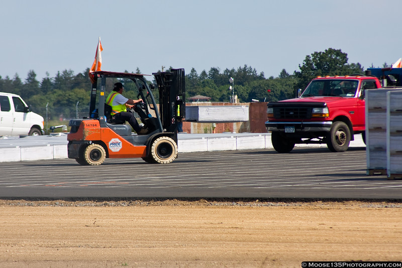 August 3 - EMAS (Engineered Materials Arresting System) being installed at Republic Airport.
