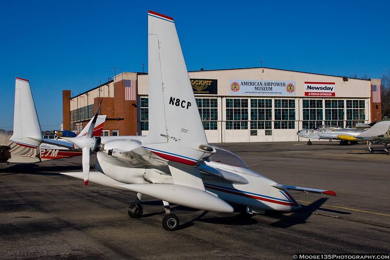 December 18 - A Rutan Long-EZ drops in to Republic Airport.