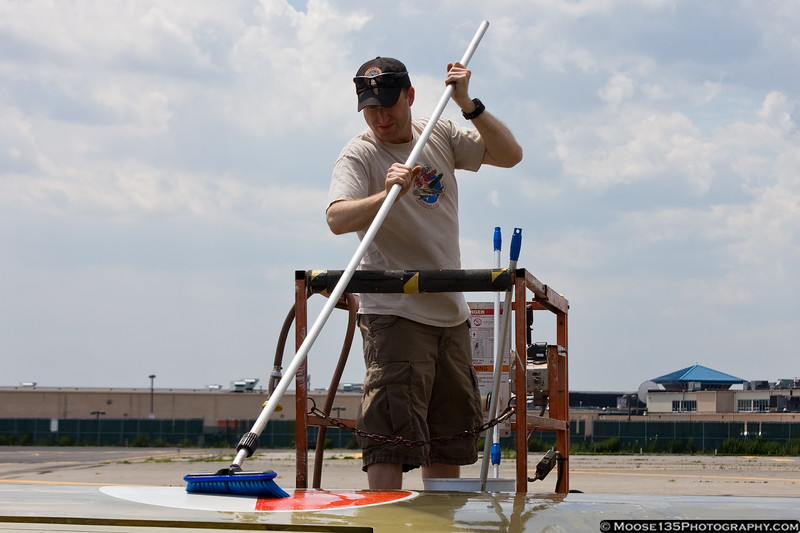 July 2 - Keeping his airplane clean, Scott Clyman washes the L-39.