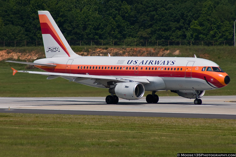 April 29 - Smile for the camera! US Airways A319 in PSA retro colors departing Charlotte/Douglas International Airport.
