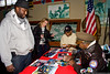 """January 22 - Tuskegee Airman Julius Freeman signs an autograph for a visitor to the American Airpower Museum.  The museum held a special event to mark the opening of the movie """"Red Tails""""."""