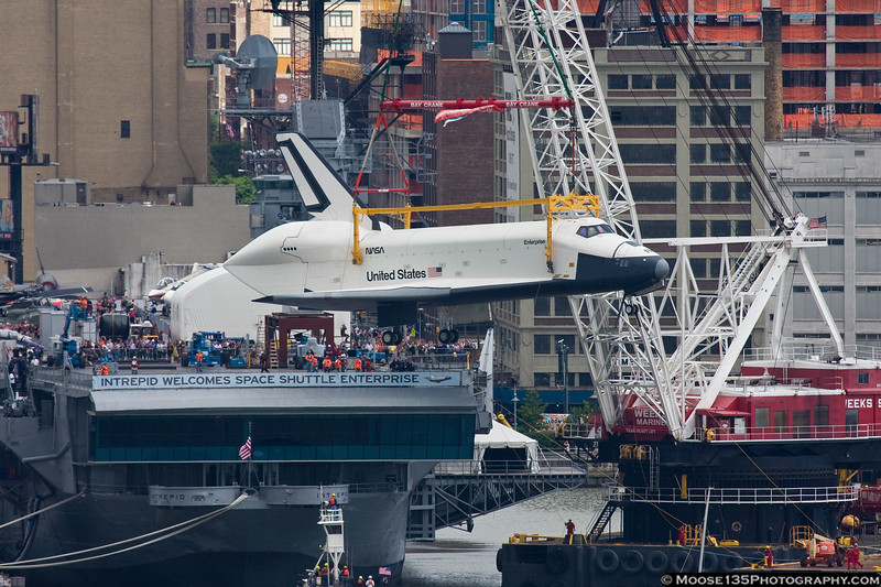 June 6 - Airborne once more! Space Shuttle Enterprise is lifted aboard the USS Intrepid.