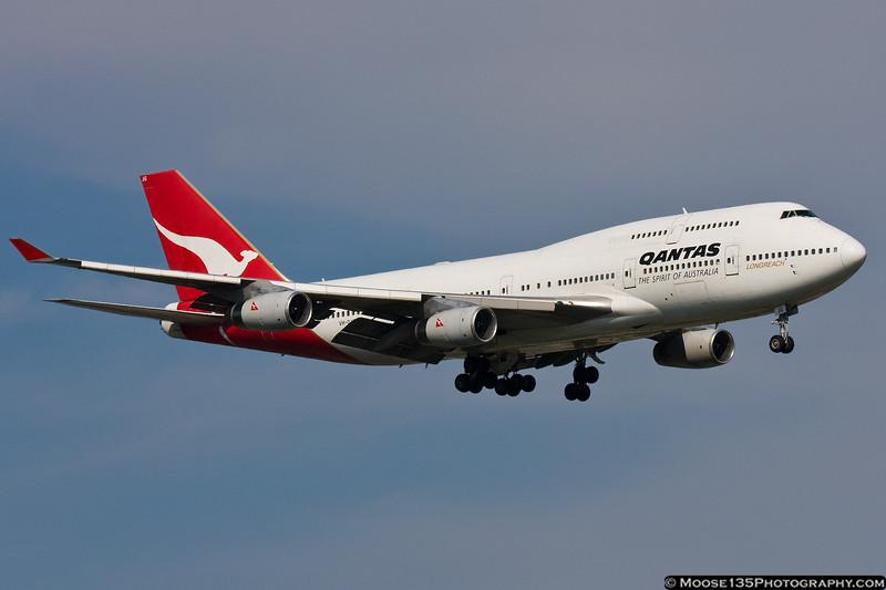 July 14 - QANTAS 747 arrives at Kennedy Airport.