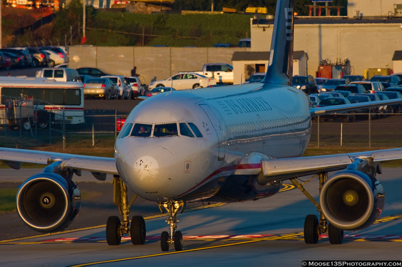 October 5 - The setting sun casts a glow on this US Airways Airbus as it prepares to depart.
