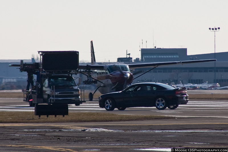 """January 24 - The television show """"Unforgettable"""" was filming on the runway at Republic Airport."""