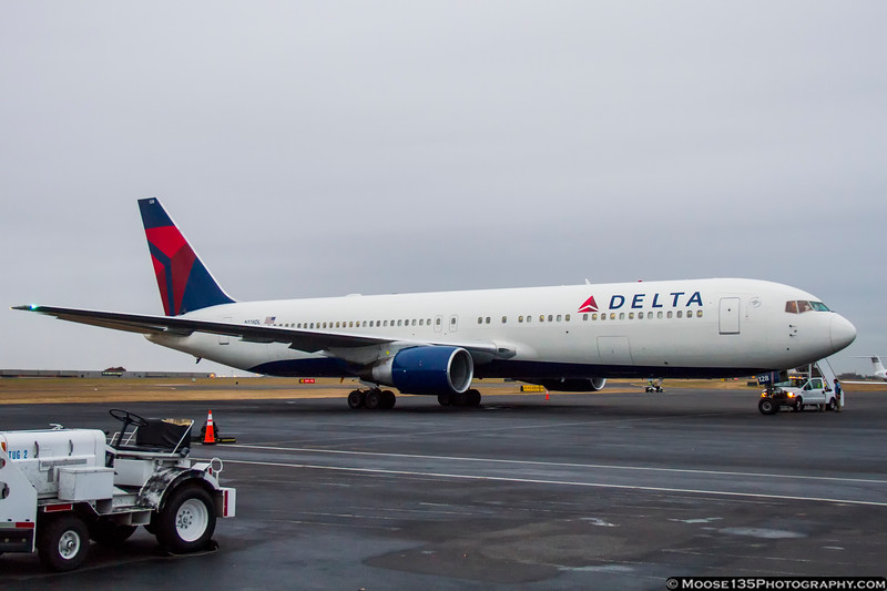 November 17 - A cloudy, damp day to catch this Delta 767, bringing the New England Patriots to town to play the Panthers.